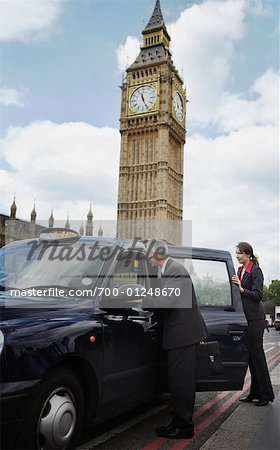 Businesspeople Getting in Taxi, London, England Stock Photo - Rights-Managed, Image code: 700-01248670