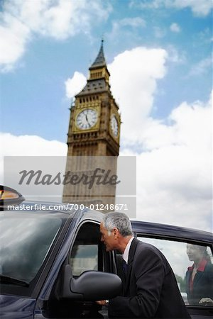 Businesspeople Getting in Taxi, London, England Stock Photo - Rights-Managed, Image code: 700-01248671