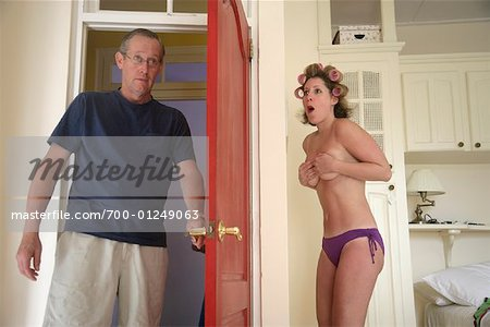 Man Walking in on Woman Changing Stock Photo - Rights-Managed, Image code: 700-01249063
