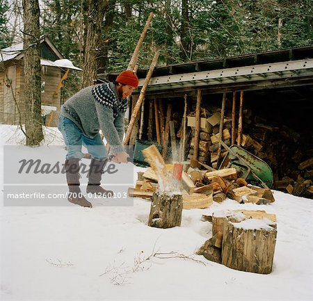 Man Chopping Firewood, South River, Ontario, Canada Stock Photo - Rights-Managed, Image code: 700-01260103