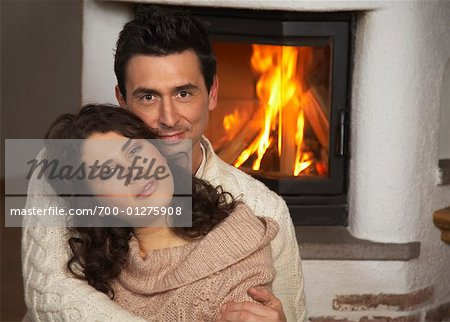Couple by Fireplace Stock Photo - Rights-Managed, Image code: 700-01275908