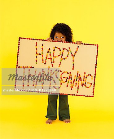 Little Girl Holding Thanksgiving Sign Stock Photo - Rights-Managed, Image code: 700-01275940