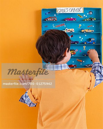 Boy Putting Away His Toys Stock Photo - Rights-Managed, Image code: 700-01275942