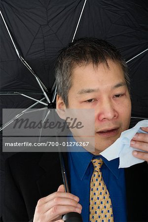 Businessman Sneezing Stock Photo - Rights-Managed, Image code: 700-01276267