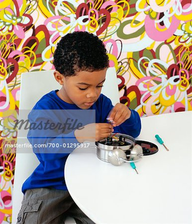Boy Fixing Alarm Clock Stock Photo - Rights-Managed, Image code: 700-01295917