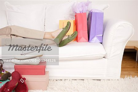 Woman on Sofa with Shoes Stock Photo - Rights-Managed, Image code: 700-01344526