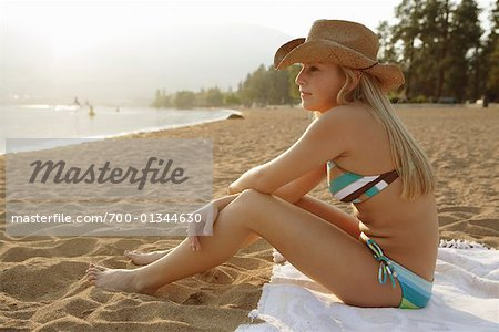 Young Woman Sitting at Beach Stock Photo - Rights-Managed, Image code: 700-01344630