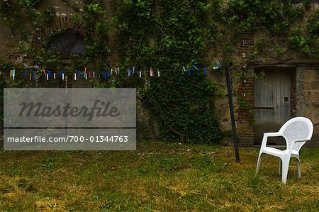 Colored Clothes Pins Against Old Wall, Villeneuve l'Archeveque, Bourgogne, France Stock Photo - Rights-Managed, Image code: 700-01344763