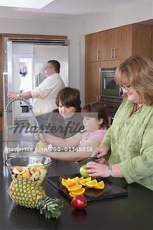 Family Making Fruit Salad Stock Photo - Rights-Managed, Image code: 700-01345018