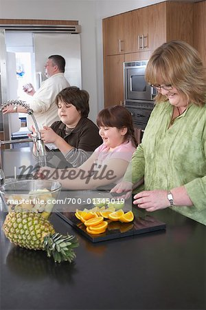 Family Making Fruit Salad Stock Photo - Rights-Managed, Image code: 700-01345019