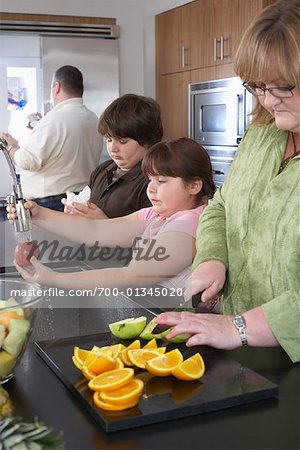 Family Making Fruit Salad Stock Photo - Rights-Managed, Image code: 700-01345020