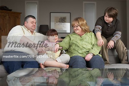 Family on Sofa with Popcorn Stock Photo - Rights-Managed, Image code: 700-01345024