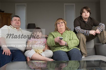 Family Watching Television with Popcorn Stock Photo - Rights-Managed, Image code: 700-01345025