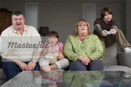 Family Playing Video Game with Popcorn Stock Photo - Rights-Managed, Image code: 700-01345026