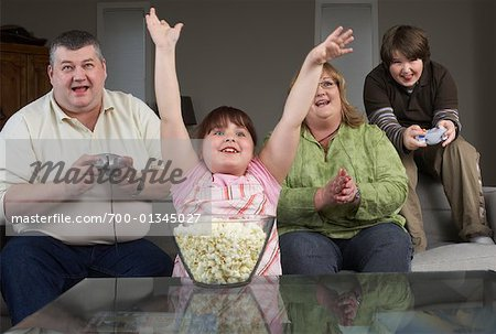 Family Playing Video Game with Popcorn Stock Photo - Rights-Managed, Image code: 700-01345027
