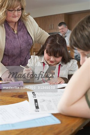 Mother Helping Children with Homework Stock Photo - Rights-Managed, Image code: 700-01345033