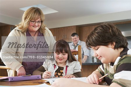 Mother Helping Children with Homework Stock Photo - Rights-Managed, Image code: 700-01345034