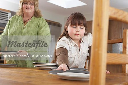 Mother and Daughter Setting Table Stock Photo - Rights-Managed, Image code: 700-01345054
