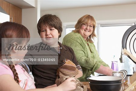 Mother and Children Washing Dishes Stock Photo - Rights-Managed, Image code: 700-01345065