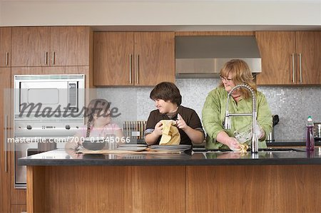 Mother and Children Washing Dishes Stock Photo - Rights-Managed, Image code: 700-01345066