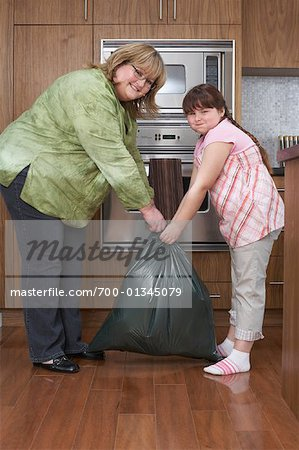 Mother and Daughter with Garbage Bag in Kitchen Stock Photo - Rights-Managed, Image code: 700-01345079