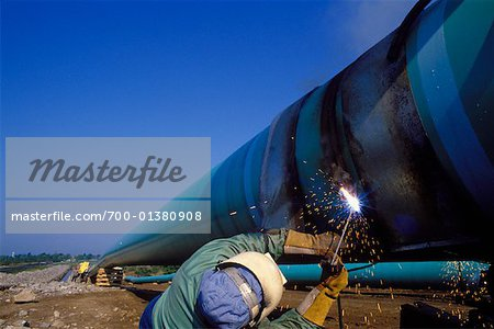 Welder Working on Natural Gas Pipeline