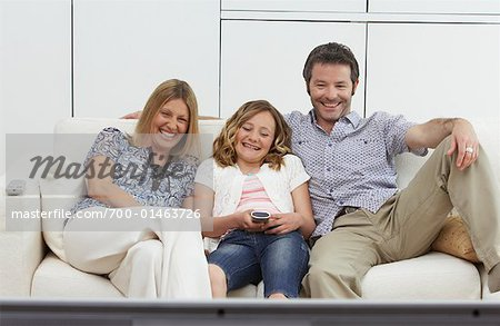 Family Watching Movie Stock Photo - Rights-Managed, Image code: 700-01463726