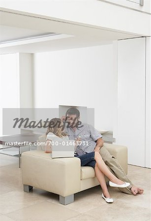 Father and Daughter on Sofa Stock Photo - Rights-Managed, Image code: 700-01463731