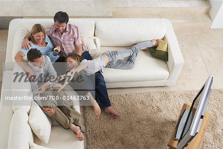 Family Watching Television Stock Photo - Rights-Managed, Image code: 700-01463763