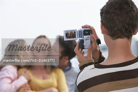 Boy Taking Video of Family Stock Photo - Rights-Managed, Image code: 700-01463771