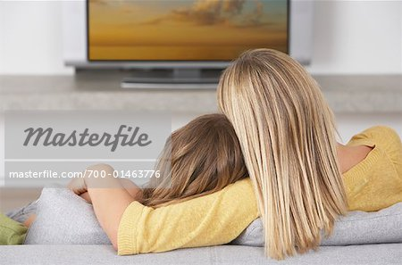Mother and Daugther Watching Television Stock Photo - Rights-Managed, Image code: 700-01463776