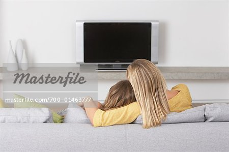 Mother and Daugther Watching Television Stock Photo - Rights-Managed, Image code: 700-01463777