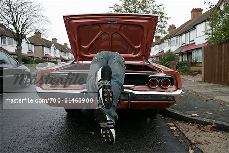 Man Looking through Trunk of American Car on English Street Stock Photo - Rights-Managed, Image code: 700-01463900