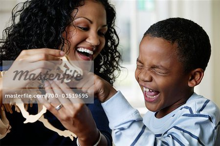 Mother and Son Playing with Dinosaur Toy Stock Photo - Rights-Managed, Image code: 700-01519695