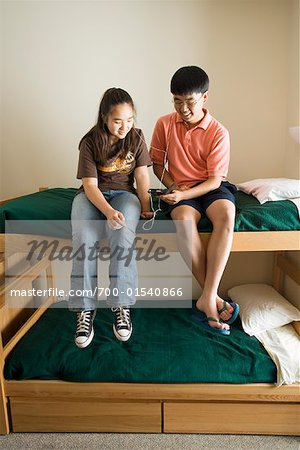 Teenagers Listening to MP3 Player Stock Photo - Rights-Managed, Image code: 700-01540866