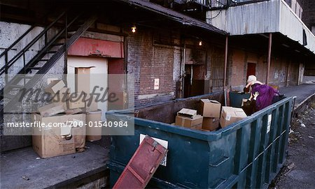 Couple in Formal Wear Climbing Out of Dumpster Stock Photo - Rights-Managed, Image code: 700-01540984