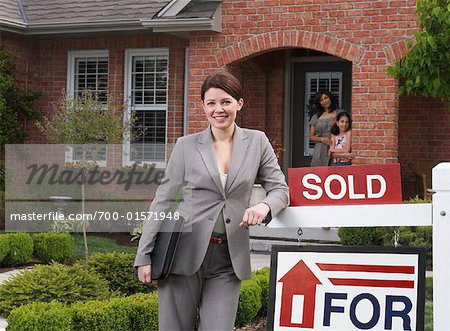 Real Estate Agent by Sold Sign Stock Photo - Rights-Managed, Image code: 700-01571948