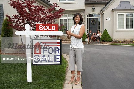 Real Estate Agent by House with Sold Sign Stock Photo - Rights-Managed, Image code: 700-01571964