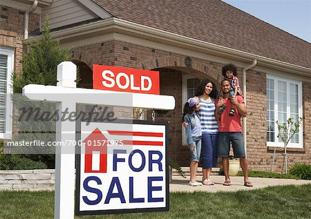 Portrait of Family by House with Sold Sign Stock Photo - Rights-Managed, Image code: 700-01571975