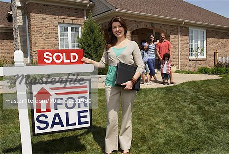 Real Estate Agent by Sold Sign Stock Photo - Rights-Managed, Image code: 700-01571980