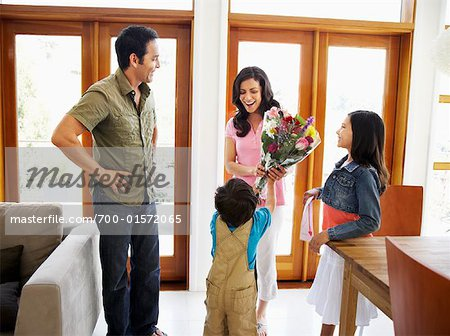 Family Giving Mother Flowers Stock Photo - Rights-Managed, Image code: 700-01572065
