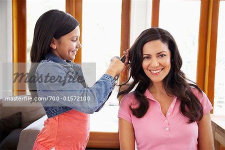 Daughter Brushing Mother's Hair Stock Photo - Rights-Managed, Image code: 700-01572100