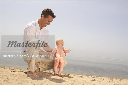 Father and Baby at Beach Stock Photo - Rights-Managed, Image code: 700-01582160