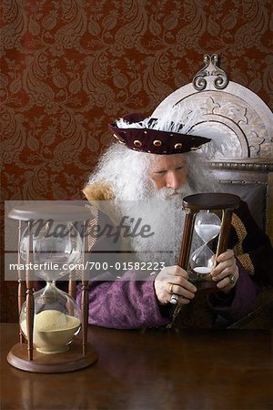 King Holding Hourglass Stock Photo - Rights-Managed, Image code: 700-01582223