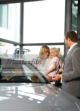 Car Salesman Selling Car to Family