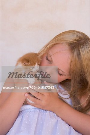 Girl Holding Kitten Stock Photo - Rights-Managed, Image code: 700-01587343