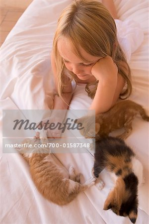 Girl with Kittens Stock Photo - Rights-Managed, Image code: 700-01587348