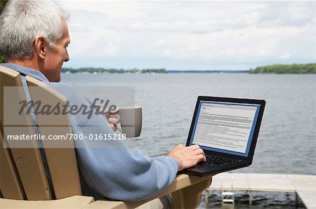 Man at the Cottage, Using Laptop Computer Stock Photo - Rights-Managed, Image code: 700-01615218