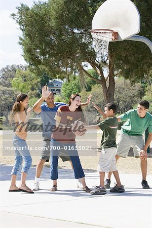 Family Playing Basketball Stock Photo - Rights-Managed, Image code: 700-01633021
