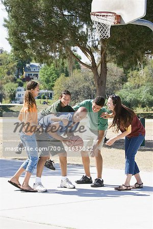 Family Playing Basketball Stock Photo - Rights-Managed, Image code: 700-01633022